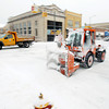 Record-Eagle/Keith King<br /> A City of Traverse City multi-purpose vehicle clears snow Tuesday, January 22, 2013 along Front Street in downtown Traverse City.