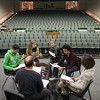 Record-Eagle/Jan-Michael Stump<br /> Clockwise from bottom left, Building Bridges With Music founder Jeff Haas; Traverse City West students Liam Thomas, Elena Mosher, Glynnis Pierce and Brian Patenaude, and Building Bridges With Music's executive director Karen McCrary rehearse the pieces they will read for Monday's Remembrance Day event at the State Theatre