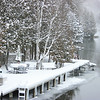 Record-Eagle/Loraine Anderson<br /> Snow surrounds a river in Antrim County on Monday.