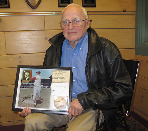 Record-Eagle/Mike Eckert<br /> <br /> Traverse City's Edwin Mucha holds his autographed baseball and photo of Stan Musial. Mucha and Musial both grew up in Donora, Penn.