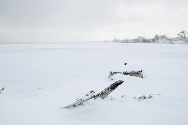 Photo Illustration/ Keith King<br /> Pilings are exposed Thursday, January 24, 2013 in West Grand Traverse Bay.