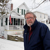 Record-Eagle/Glenn Puit<br /> John Keeling stands in front of the home he's lived in for 27 years on 6th Street. He had a sale of the home all lined up this Fall, but the deal fell through because of a last-minute mixup over whether the home requires flood insurance.