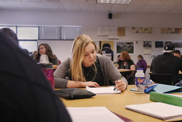 Record-Eagle/Keith King<br /> Northwestern Michigan College (NMC) dual-enrollment student, Maggy Gordon, works with classmates Thursday, January 17, 2013 as they prepare for a quiz in their United States history class.