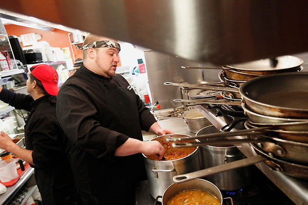 Record-Eagle/Jan-Michael Stump<br /> Soul Hole chef Scott Williams' stirs his Texas Tornado chili, which is simmered for 10 hours.