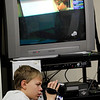Record-Eagle/Jan-Michael Stump<br /> Fifth grader Jacob Pawloski works the camera as classmates read the news on to classrooms in Central Grade School.