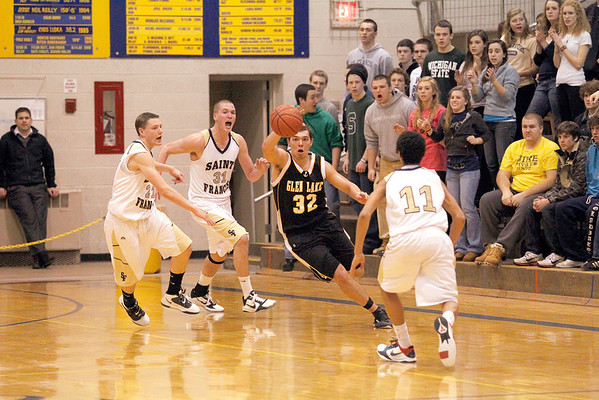 Record-Eagle/Jan-Michael Stump<br /> Glen Lake's Matt O'Brien (32) chases down a ball tipped from Traverse City St. Francis' Sean Sheldon (31) as Byron Bullough (21) and Devin Sheey-Guiseppi run to help near the end of Tuesday's game.