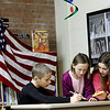 Record-Eagle/Jan-Michael Stump<br /> Fifth grade students Dawson Craker, left, Mary Swick, center, and Jessie Cairns prepare their scripts to read the news on camera to classrooms in Willow Hill Elementary School.