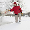 Record-Eagle/Keith King<br /> Larry Krawczak, of Empire Township, spreads fireplace ash, which provides nutrients, around his maple trees Tuesday.