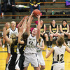 Record-Eagle/Jan-Michael Stump<br /> Traverse City St. Francis' Bridget Bussell (42) grabs a rebound from Traverse City Central's Claire Young (22) and Abby Underwood  (11) in the second quarter of Tuesday's game.