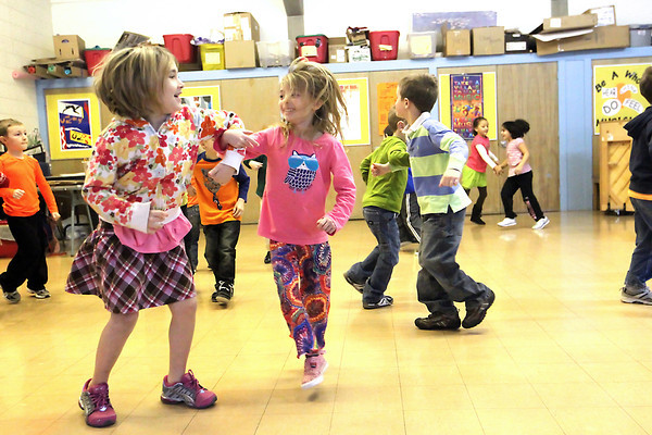 Record-Eagle/Jan-Michael Stump<br /> Eastern Elementary School kindergarteners Lydia Hess (cq), left, and Addie Kuberski (cq) dance with classmates in music class Friday.