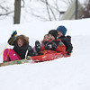 Record-Eagle/Jan-Michael Stump<br /> From left, Olivia Bageris, 6, Erin Hale, 5, James Gerhardt, 5 and Cole Kratky, 5, sled at Hannah Park Monday in Traverse City after nearly five inches of heavy, wet snow fell overnight.
