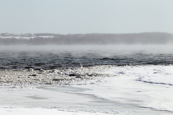 Record-Eagle/Jan-Michael Stump<br /> East Grand Traverse Bay, seen here facing east, remains largely ice-free on Thursday, January 24, 2013.