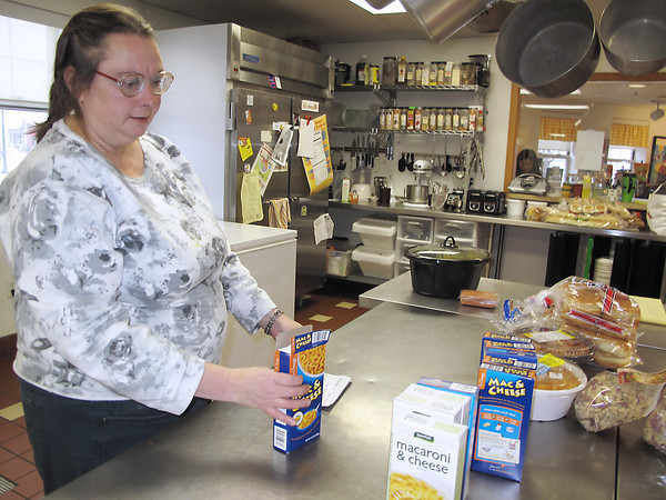 Sue Orchard, 53, works in the kitchen of Traverse House Clubhouse on Hall Street. Record-Eagle/Glenn Puit
