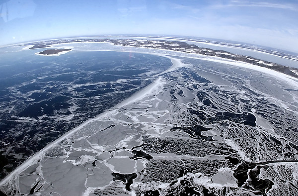 """Record-Eagle file photo/Jim Bovin<br /> An aerial photo  East and West Bay taken from a U.S. Coast Guard plane shows ice cover on Feb. 17, 2003, a year the West Bay did freeze over for 42 days. Ice must freeze from the southern shore of West Bay about six miles out to Power Island to officially be considered """"frozen."""""""