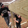 Record-Eagle/Jan-Michael Stump<br /> Mark Bagwell, left, and Jason Ball set up the Michigan Gutters booth for the 2013 Home Builder's Association Expo at the Grand Traverse Resort and Spa in Acme.
