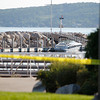 Record-Eagle/Jan-Michael Stump<br /> Officials investigate the scene where 18 year-old Mancelona resident Michael Knudsen (cq) drowned while swimming off of Dock F in Clinch Marina Monday night.