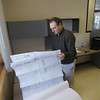 Record-Eagle/Keith King<br /> Troy Bamberg, Preston Feather Building Centers general manager, looks over blueprints for a lumber storage racking system Thursday, January 24, 2013 as work takes place to open the Preston Feather Building Centers facility in Blair Township.