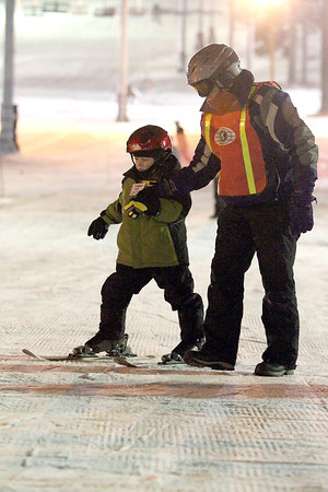 Record-Eagle/Jan-Michael Stump<br /> Kiwanis Ski School instructor Mat Wiliford (cq) helps Cooper Lennox (cq) down the Peter Rabbit run Wednesday night at Mt. Holiday.
