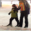 Record-Eagle/Jan-Michael Stump<br /> Kiwanis Ski School instructor Mat Wiliford (cq) helps Cooper Lennox (cq) down the Peter Rabbit run Wednesday night at Mt. Holiday.