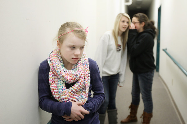 Photo Illustration/ Keith King<br /> Caylee White, 12, from left, Veronica Faller, 17 and Hannah Brown, 17, all of Traverse City and all members of the Old Town Playhouse Young Company, stage a bullying scene Wednesday, January 23, 2013 at the Old Town Playhouse in Traverse City.