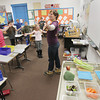 Record-Eagle/Keith King<br /> Kirsten Gerbatsch, with FoodCorps, performs a song that focuses on roots, stems, leaves, flowers, fruits and seeds Friday, January 25, 2013 with third-grade students at Platte River Elementary School.