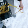 Record-Eagle/Jan-Michael Stump<br /> Jack Olson, 10, laces up his skates at F&M Park on Friday afternoon.