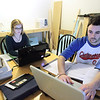 Record-Eagle/Keith King<br /> From left, Mary Kate Rea, of California, and Will Thompson, of New Hampshire, do homework in Will's apartment on the campus of NMC.
