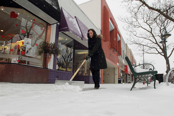 "Record-Eagle/Keith King<br /> Donna Vannatter, sales associate with Miner's North Jewelers, shovels snow from the sidewalk. ""I like it; I don't mind going outside to get the fresh air,"" Vannatter said."