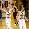 Record-Eagle/Jan-Michael Stump<br /> Traverse City St. Francis's Sean Sheldon (31) and Christopher Miller (25) celebrate after a 17-0 run against Charlevoix in the third quarter of Friday's game.