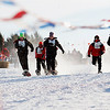 Record-Eagle/Jan-Michael Stump<br /> Competitors in the 75 meter snowshoe finals head for the finish line.