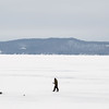 Record-Eagle/Keith King<br /> An ice fisherman walks on Glen Lake.