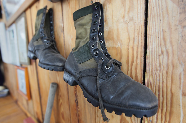 Record-Eagle/Keith King<br /> Boots belonging to Bob Hanley, of Acme Township, are displayed at his home. The boots were worn by Hanley when he served in the U.S. Marine Corps in Vietnam.