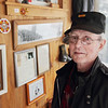 Record-Eagle/Keith King<br /> Bob Hanley, of Acme Township, with his Vietnam Service Medal ribbon on his hat,  stands in his home near items relating to his time with the U.S. Marine Corps.