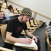 Record-Eagle/Keith King<br /> Will Mitchell, of Traverse City, writes as part of a warm-up exercise in an introductory English combined 11 & 111 class at Northwestern Michigan College.