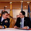 "Record-Eagle/Jan-Michael Stump<br /> ""This is special, and so are you. This is a first,"" said Rear Admiral Michael Parks, of the United States Coast Guard Ninth District, left, to Chairman Derek Bailey of The Grand Traverse Band of Ottawa and Chippewa Indians just before the two signed a memorandum of understanding to formalize and enhance cultural, operational and community coordination. It is the first such memorandum between a tribal authority and the United States Coast Guard."