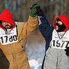 Record-Eagle/Jan-Michael Stump<br /> Larry Schaub (left), gets congratulated by Joseph Tacconelli on the winner's stand after their 75 meter snowshoe race in the Special Olympics Michigan Winter games.