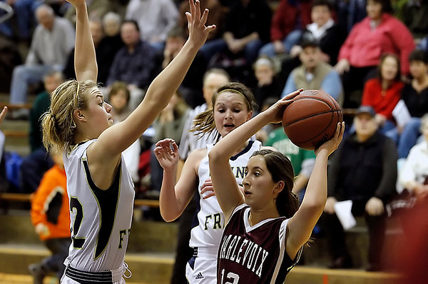 Record-Eagle/Jan-Michael Stump<br /> Traverse City St. Francis' Liza Erickson (32) defends Charlevoix's Sydney Carlson (12) on Friday.