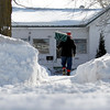 Record-Eagle/Jan-Michael Stump<br /> Jim Penell finishes shoveling the walk of his home on Second Street on Wednesday afternoon.
