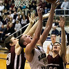 Record-Eagle/Jan-Michael Stump<br /> Charlevoix's Brennan Ackerman (43) and Joseph Filipiak (11) fight for a rebound with Traverse City St. Francis' Sean Sheldon (31) in the third quarter of Friday's game.