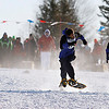 Record-Eagle/Jan-Michael Stump<br /> From left, Christopher Smith, Lacostiest Williams and Tony Perez compete in the  during Thursday's Special Olympics Michigan Winter games 75 meter snowshoe race finals at the Grand Traverse Resort and Spa in Acme.