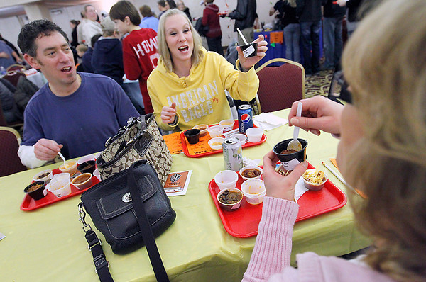 Record-Eagle/Jan-Michael Stump<br /> Matt Richardson, left; Kasey McLean, center; and Beth Richardson, right, discuss their chili samples during Saturday's 17th annual Downtown Chili Cook-Off at the Park Place Dome in downtown Traverse City. Approximately 1,400 people attended the event, and Mt. Holiday's white chili was the overall favorite, claiming the People's Choice award. Thirteen area restaurants enetered 16 different chilis. Other winners were: Hanna Bistro, 1-Alarm; Union Cantina, 2-Alarm; Soul Hole, 3-Alarm and No Bean; Scalawags Whitefish and Chips, Seafood; and Oryana Lake St. Cafe, Vegetarian.
