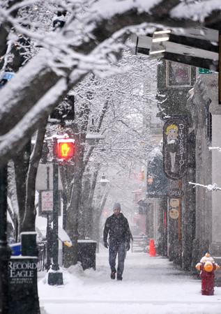 Record-Eagle/Dan Nielsen<br /> A pedestrian trudges along Front Street during a snowstorm.