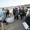 Record-Eagle/Keith King<br /> Father Ciprian Streza of the Archangel Gabriel Greek Orthodox Church conducts the Great Blessing of the Waters Saturday, January 5, 2013 at the Duncan L. Clinch Marina pier on West Grand Traverse Bay in Traverse City.