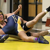 Record-Eagle/Jan-Michael Stump<br /> Traverse City Central's Andre Passos, left, and Gaylord's Trent Hunt wrestle at 152 during Wednesday's match.
