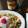 Record-Eagle/Keith King<br /> <br /> Green curry chicken (coconut curry sauce, mixed vegetables and rice) along with a bottle of L. Mawby Vineyards Fizz demi-sec sparkling wine lie on a table Thursday, December 13, 2012 at Xylo Bistro Cafe in Traverse City's Warehouse District.