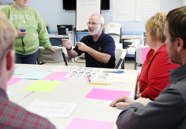 Record-Eagle/Keith King<br /> Darrell Rogers, Northwestern Michigan College training specialist, conducts a Lean Manufacturing Champion training program session Tuesday, January 8, 2013 at the Armor Express plant in Central Lake.