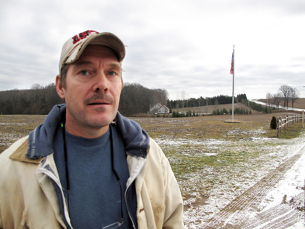 Record-Eagle/Glenn Puit<br /> Kevin Lopez, 48, stands on his Leelanau County property on Wednesday, Dec. 19, 2012. Lopez is fed up with what he sees as unfair billing practices by propane providers in northern Michigan.