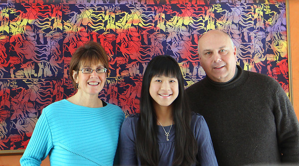 Record-Eagle/Jan-Michael Stump<br /> Betsy, Lia, and Mark Williams will be among the hosts when a group of Chinese exchange students visit Traverse City later this month.