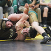 Record-Eagle/Jan-Michael Stump<br /> Traverse City West's Caleb Kase, top, defeated Ogemaw Heights' Cole Sammons at 140 pounds during Wednesday's match.