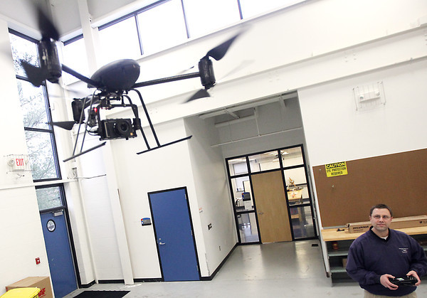 Record-Eagle/Keith King<br /> Tony Sauerbrey, Northwestern Michigan College (NMC) Aviation Division Unmanned Aerial Systems (UAS) program manager, demonstrates a remotely piloted aircraft (RPA) Friday, January 11, 2013 in the Parsens-Stulen Building at the Northwestern Michigan College Aero Park Campus.